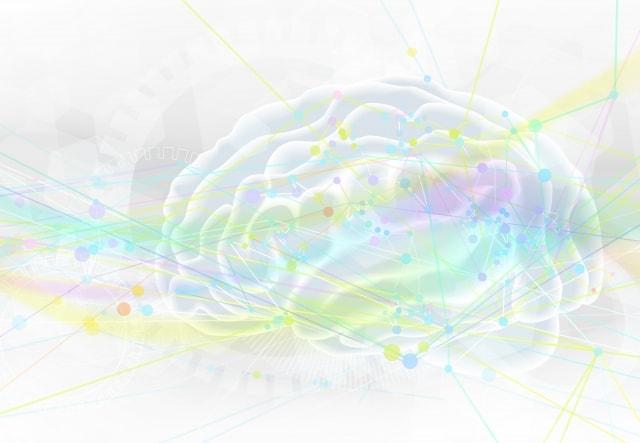 カラフルな光に包まれている脳のイラスト